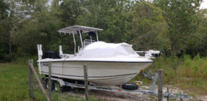 Angler 204 center console boat fishing camping sandbar with bow dodger from marine canopy