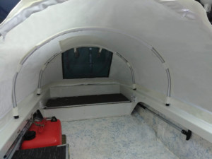 Boston Whaler 14ft tiller drive boat with a bow dodger shade cabin tent shelter by Marine Canopy