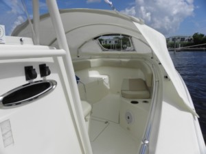 Cobia 277 center console fishing boat with bow tent dodger sun shade shelter