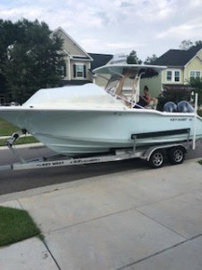 Key West 244 center console fishing boat with The Element bow boat tent