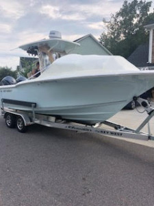 Key West 244 center console fishing boat with universal fit bow dodger by Marine Canopy