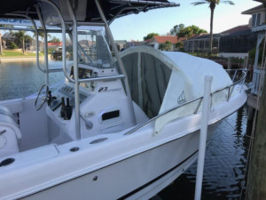 Pro-Line 23 Sport center console fishing boat with bow shade dodger by Marine Canopy