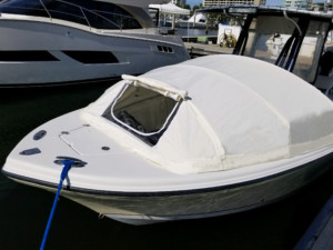 Sailfish 2360 center console fishing boat with The Element bow dodger boat tent cabin by Marine Canopy