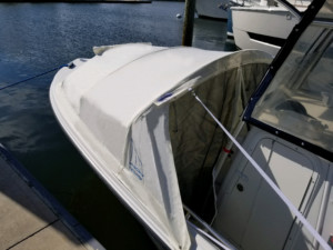 Sailfish 2360 CC with The Element bow dodger boat tent cabin by Marine Canopy