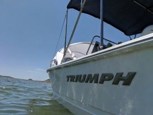 Triumph 170 center console fishing boat with bow shade bow cover by Marine Canopy
