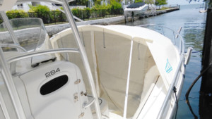 Mako 284 center console fishing boat with The Element bow dodger instant cabin bow shade