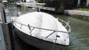 Mako 284 center console fishing boat with The Element bow dodger sprayhood bow tent shade
