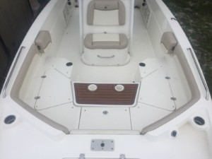 NauticStar 231 coastal center console boat with The Element bow dodger marince canvas cabin tent